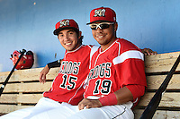Batavia Muckdogs Hiram Martinez (15) and Luis Alberto Sanz (19) in the dugout during a game against the Williamsport Crosscutters on July 27, 2014 at Dwyer Stadium in Batavia, New York.  Batavia defeated Williamsport 6-5.  (Mike Janes/Four Seam Images)