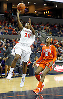Virginia guard Faith Randolph (20) puts in the break away ball in front of Clemson forward/center Quinyotta Pettaway (12) during the game Sunday in Charlottesville, VA. Photo/The Daily Progress/Andrew Shurtleff
