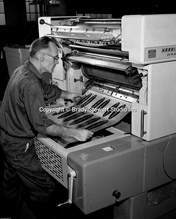 Pittsburgh PA - View of a printing press operator creating a printing plate using the Harris printing equipment.  On site photography at Colonial Press Company at the Try Street Terminal Building.<br />