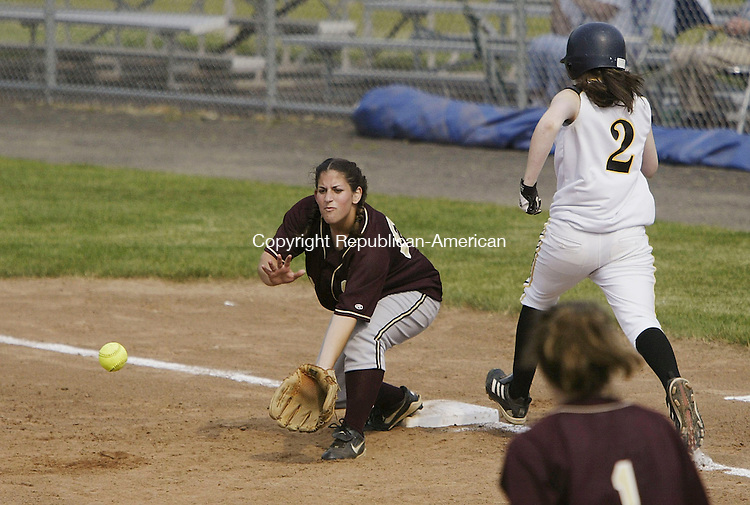 WEST HAVEN, CT - 06 June 2005 -060605BZ03- Sacred Heart #25, Marybeth Woods waits for the ball at first as Thomaston #2, Sara Sanford stretches for the bag during the Class S semifinal at West Haven Monday afternoon. <br /> Jamison C. Bazinet Photo