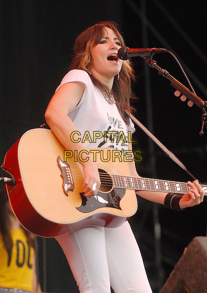 KT TUNSTALL.Performing live at the 2007 V Festival, Hylands Park, Chelmsford, England..August 19th, 2007.half length stage concert live gig performance music guitar white singing microphone 3/4 .CAP/BEL.©Belcher/Capital Pictures