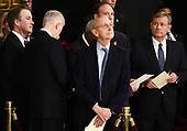 Memebers of the Supreme Court Brett Kavanaugh (L), Neil Gorsuch (2L), Stephen Breyer, and John Roberts (R) wait for the casket containing the remains of former US President George H.W. Bush to arrive at the US Capitol during a State Funeral in Washington, DC, December 3, 2018. - The body of the late former President George H.W. Bush will travel from Houston to Washington, where he will lie in state at the US Capitol through Wednesday morning. Bush, who died on November 30, will return to Houston for his funeral on Thursday. (Photo by Brendan SMIALOWSKI / AFP)