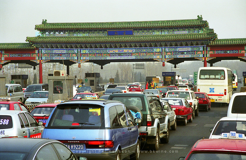 A road toll barrier at the entrance to Beijing - not the usual iron and concrete