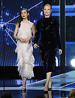 MOUNTAIN VIEW, CA - DECEMBER 3: Julia Milner and Lily Collins appear on the 6th Annual Breakthrough Prize at NASA Ames Research Center on December 3, 2017 in Mountain View, California. (Photo by Frank Micelotta/NatGeo/PictureGroup)