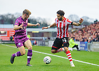 Lincoln City's Bruno Andrade vies for possession with Carlisle United's Jack Sowerby<br /> <br /> Photographer Chris Vaughan/CameraSport<br /> <br /> The Emirates FA Cup Second Round - Lincoln City v Carlisle United - Saturday 1st December 2018 - Sincil Bank - Lincoln<br />  <br /> World Copyright © 2018 CameraSport. All rights reserved. 43 Linden Ave. Countesthorpe. Leicester. England. LE8 5PG - Tel: +44 (0) 116 277 4147 - admin@camerasport.com - www.camerasport.com