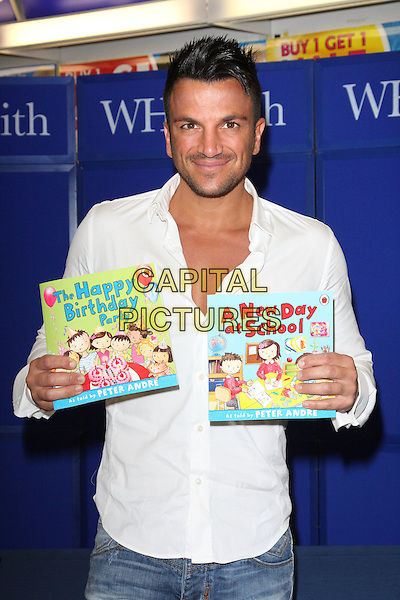 Peter Andre at a signing in WH Smith, Milton Keynes to launch his new range of children's books - published by Ladybird. Titles include 'A New Day at School' and 'The Happy Birthday Party', Milton Keynes, England..September 5th 2011.half length white shirt.CAP/JIL.©Jill Mayhew/Capital Pictures