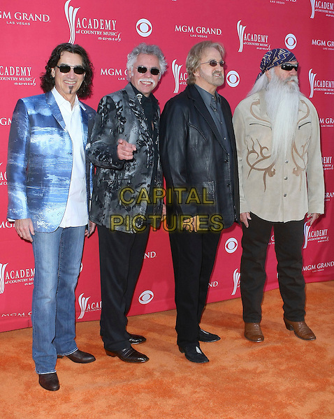 THE OAK RIDGE BOYS  - Duane Allen, Joe Bonsall, William Lee Golden and Richard Sterban.44th Annual Academy Of Country Music Awards held at the MGM Grand Garden Arena, Las Vegas, Nevada, USA, .5th April 2009. .full length denim blue jacket blazer print sunglasses leather finger .CAP/ADM/MJT.©MJT/Admedia/Capital Pictures