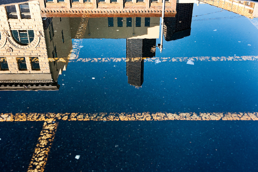 A water reflection photograph captured in a parking lot in Pioneer Square, in Seattle.