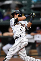 Angel Aguilar (2) of the Charleston RiverDogs with the South team bats during the South Atlantic League All-Star Game on Tuesday, June 20, 2017, at Spirit Communications Park in Columbia, South Carolina. The game was suspended due to rain after seven innings tied, 3-3. (Tom Priddy/Four Seam Images)