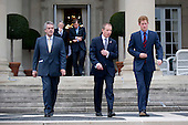 Prince Harry (R) and Sir Peter Westmacott (L), the British Ambassador to the United States, arrive for a reception at the British Ambassador's Residence in recognition of U.S. and British wounded warriors, in Washington, D.C. on May 7, 2012.  .Credit: Kevin Dietsch / Pool via CNP