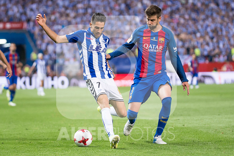Deportivo Alaves's forward Ruben Sobrino and FC Barcelona's defender Gerard Pique during Copa del Rey (King's Cup) Final between Deportivo Alaves and FC Barcelona at Vicente Calderon Stadium in Madrid, May 27, 2017. Spain.<br /> (ALTERPHOTOS/BorjaB.Hojas)