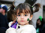 A little girl looks on as the annual St. Patrick's Day Parade marches down the streets of Manhattan in New York City on March 17, 2011.