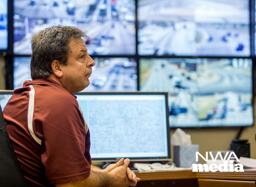 NWA Democrat-Gazette/JASON IVESTER <br /> Rob Kintz (cq) monitors traffic cameras on Thursday, Dec. 10, 2015, inside the Bentonville Traffic Management Center.