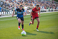 Kansas City, Mo. - Saturday April 23, 2016: FC Kansas City midfielder Heather O'Reilly (9) and Portland Thorns FC defender Emily Menges (4) chase down a ball during a match at Swope Soccer Village. The match ended in a 1-1 draw.