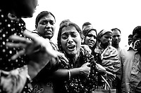 Shohels wife mourn for her husband, who trapped inside the rubble of the collapsed Rana Plaza building, in Savar, near Dhaka, Bangladesh.