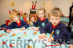 junior infants Marcell, Abby and Ciun form Listellick NS enjoying the Christmas Exhibition at the Tralee Museum on Tuesday