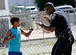 (Boston, MA, 06/22/16) Boston Police officer Joshua De La Rosa teaches Ronnie Villar, 11, how to box in Villar's Roslindale neighborhood on Wednesday, June 22, 2016. Photo by Christopher Evans