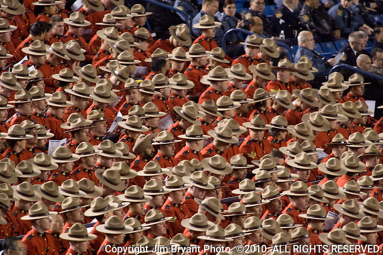 Royal Canadian Mounted Police fill a portion of the arena at a memorial service for four slain Lakewood police officers during a memorial service at the Tacoma Dome on December  8, 2009 in Tacoma, WA. Tina Griswold along with sergeant Mark Renninger, officer Ronald Owens and officer Greg Richards were shot and killed at a coffee shop in the Tacoma suburb of Parkland, November 29 by Maurice Clemmons, who was later shot and killed by police.  Jim Bryant Photo. ©2010. ALL RIGHTS RESERVED.