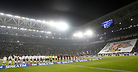 Juventus and Roma players line up prior to the start of their Italian Serie A football match at Juventus Stadium.