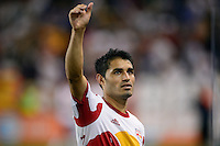 Fabian Espindola (9) of the New York Red Bulls salutes the fans after the match. The New York Red Bulls defeated Real Salt Lake 4-3 during a Major League Soccer (MLS) match at Red Bull Arena in Harrison, NJ, on July 27, 2013.