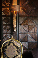 Detail of the wall covering, a decorative Berber technique consisting of bay tree branches woven together to create a geometrical pattern