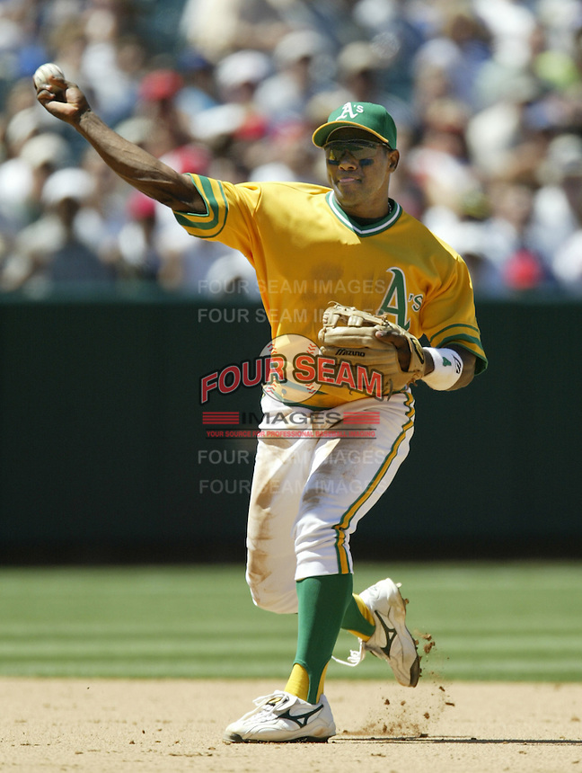 Miguel Tejada of the Oakland Athletics makes a throw during a 2002 MLB season game against the Los Angeles Angels at Angel Stadium, in Anaheim, California. (Larry Goren/Four Seam Images)