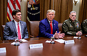 United States President Donald J. Trump answers a reporter's question as he participates in a briefing with senior military leaders in the Cabinet Room of the White House in Washington, DC on Monday, October 7, 2019.  At left is United States Secretary of Defense Dr. Mark T. Esper, left, and at right is United States Army General Mark A. Milley, Chairman of the Joint Chiefs of Staff.<br /> Credit: Ron Sachs / Pool via CNP