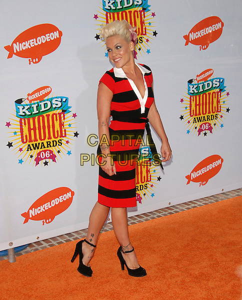 PINK.Arrivals at The Nickelodeon's 19th Annual Kids' Choice Awards held at UCLA's Pauley Pavilion in Westwood, California, USA, April 1st 2006..full length red and black striped dress rugby shirt belt shoes tattoo tattooes music pinnk hair quiff looking back behind.Ref: DVS.www.capitalpictures.com.sales@capitalpictures.com.©Debbie VanStory/Capital Pictures