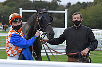 Winner of The Racing TV Handicap Stakes Mere Anarchy (Orange/white cap 2r) ridden by Kieran Shoemark and trained by Robert Stephens in the Winners enclosure during Horse Racing at Salisbury Racecourse on 11th September 2020