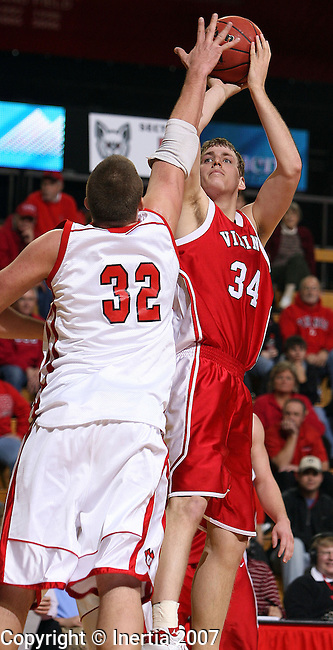 Gabe Bross, #34 of Dana College, looks for the jumper over Rane Mergen, #32 of the University of South Dakota in the second half Saturday night, November 17, 2007, at the DakotaDome in Vermillion. (photo by Dave Eggen/Inertia)