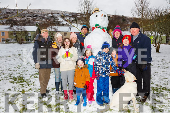 'We can build a snowman', pictured with their eight foot snowman in the Fair Filed in Cahersiveen on Friday were front l-r; Jayden McCarthy, Tommy Clifford, Lucy O'Connell, Killian O'Connell, Tadhg Clifford, Katie O'Connell, back l-r; Chris Kelly, Laura McCarthy, Sarah Clifford, Eddie Clifford, Fiona & Mike O'Connell.