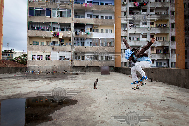 Armando Vilanculos, aka Ruben, makes a jump at the skatepark that the Associacoa do Skate de Mozambique have, with the help of funding from Skate Aid, built themselves above an underground car park. /Felix Features