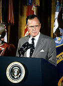 United States President George H.W. Bush makes remarks as he and first lady Barbara Bush present the Presidential Medal of Freedom during a ceremony in the East Room of the White House in Washington, DC on July 3, 1991. The President is honoring key members of his staff for their efforts to ensure the success of Operation Desert Shield / Operation Desert Storm and the liberation of Kuwait.<br /> Credit: Ron Sachs / CNP