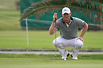 Chris Wood (ENG) lines up his putt on the 18th green during Day 2 Friday of the Open de Andalucia de Golf at Parador Golf Club Malaga 25th March 2011. (Photo Eoin Clarke/Golffile 2011)