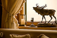 Close up of a pair of 20th century bronze statues of deer on the window sill of the living room