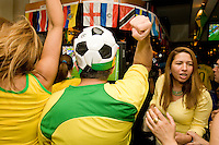 Brazil fans cheer on their team in a match against Australia on June 18, 2006 at the Emporium, a restaurant in a section of New York City known as &quot;Little Brazil&quot;.<br /> <br /> The World Cup, held every four years in different locales, is the world's pre-eminent sports tournament in the world's most popular sport, soccer (or football, as most of the world calls it).  Qualification for the World Cup is open to any country with a national team accredited by FIFA, world soccer's governing body. The first World Cup, organized by FIFA in response to the popularity of the first Olympic Games' soccer tournaments, was held in 1930 in Uruguay and was participated in by 13 nations.    <br /> <br /> As of 2010 there are 208 such teams.  The final field of the World Cup is narrowed down to 32 national teams in the three years preceding the tournament, with each region of the world allotted a specific number of spots.  <br /> <br /> The World Cup is the most widely regularly watched event in the world, with soccer teams being a source of national pride.  In most nations, the whole country is at a standstill when their team is playing in the tournament, everyone's eyes glued to their televisions or their ears to the radio, to see if their team will prevail.  While the United States in general is a conspicuous exception to the grip of World Cup fever there is one city that is a rather large exception to that rule.  In New York City, the most diverse city in a nation of immigrants, the melting pot that is America is on full display as fans of all nations gather in all possible venues to watch their teams and celebrate where they have come from.