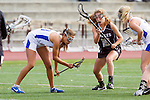 Torrance, CA 05/09/13 - Kelsie Garrison (Agoura #23) and Rachel Julius (Oak Park #19) in action during the 2013 Los Angeles area Girls Varsity Lacrosse Championship.  Agoura defeated Oak Park 13-7.