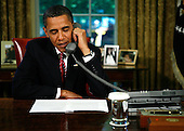 Washington, DC - May 20, 2009 -- United States President Barack Obama calls the crew of the Space Shuttle Atlantis from the Oval Office of the White House, Wednesday, May 20, 2009 in Washington, DC. The shuttle crew has been on a Hubble Space Telescope repair mission and is scheduled for a May 22 landing at the Kennedy Space Center. .Credit: Alex Wong - Pool via CNP