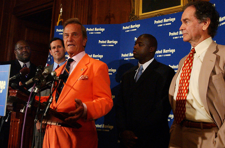 From left, Marvin Winans, gospel singer, Sen. Rick Santorum, R-Pa., singer Pat Boone, Darrell Green, former Redskin, and actor Dean Jones, appear at a news conference in support of the amendment that would ban same sex marriage.