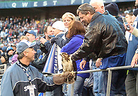 27 Nov 2005:   Seattle Seahawk fans got the chance to pet the Seahawks Hawk held by his handler Dave Knutson during the fourth quarter against the New York Giants at Quest Field in Seattle, WA.