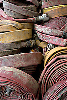 Rolled fire service hose after being used at a fire. This image may only be used to portray the subject in a positive manner..©shoutpictures.com..john@shoutpictures.com