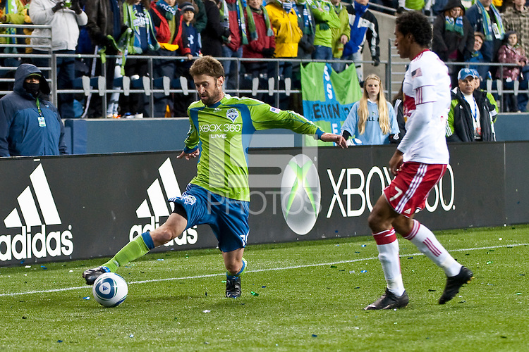 Pat Noonan (l) passes the ball against Roy Miller (r)  as the Seattle Sounders lost to the New York Red Bulls, 1-0, in an MLS match on Saturday, April 3, 2010 at Qwest Field in Seattle, WA.