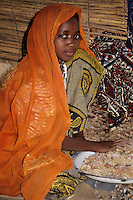 Gum Arabic.  Hausa Woman Removing Straw and Dirt by Hand.  Niamey, Niger, West Africa.