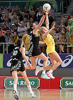 16.09.2012 Silver Ferns Leana de Bruin and Australian Erin Bell in action during the first netball test match between the Silver Ferns and the Australian Diamonds played at the Hisense Arena In Melbourne. Mandatory Photo Credit ©Michael Bradley.