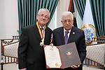 Palestinian President Mahmoud Abbas honors the Milko Dolinšek, the representative of the Republic of Slovenia to Palestine, at his headquarter, in the West Bank city of Ramallah, June 16, 2019. Photo by Thaer Ganaim