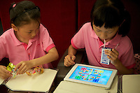 Chinese girls play iPad game on a CRH (China Railway High-Speed) train traveling between Shanghai and Beijing. 10 Jul 2011 CRH is similar to French TGV or Japanese 'bullet trains'. It had the fastest conventional train service in the world and the line reach a top speed of 330km/hr..10 Jul 2011