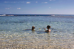 A woman and her dog play in the waters off Obyan Beach on the far south of Saipan.  .Robert Gilhooly Photo