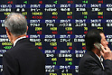May 13, 2010 - Tokyo, Japan - Pedestrians walk past an electronic stock board at the Tokyo Stock Exchange in Tokyo, Japan, on May 13, 2010. Tokyo stocks rose the most in two weeks as more companies raised their profit forecasts and after Spain's deficit reduction plan eased worries about Europe's debt mountain and good economic news sent U.S. stocks sharply higher.