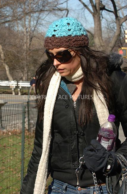 WWW.ACEPIXS.COM . . . . . ....NEW YORK, FEBRUARY 21 2006....Famke Janssen taking a walk with her dog in Central Park. ....Please byline: BRETT KAFFEE-ACEPIXS.COM.... *** ***..Ace Pictures, Inc:  ..Philip Vaughan (212) 243-8787 or (646) 769 0430..e-mail: info@acepixs.com..web: http://www.acepixs.com
