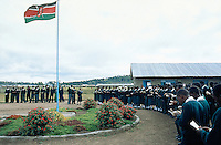 Kenya. Rift Valley Province. Nyahururu. Munyaka secondary school. Students stay on line in the early morning for the rising of the kenyan flag. The boys and girls are wearing the same green uniform. © 2004 Didier Ruef